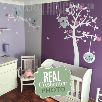The Koala Trees Wall Art Sticker is a tree with 2 branches and 4 koalas as well.