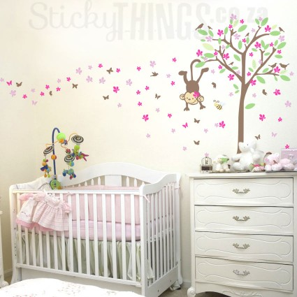 This girls wall decal is a tree with a swinging monkey, leaves, birds and loads of little flowers in 2 colours.