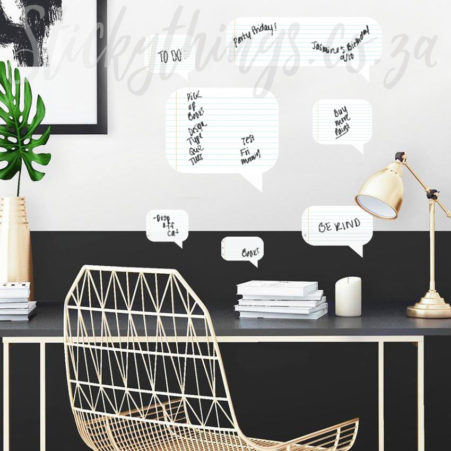 Dry Erase Speech Bubble Wall Decal with writing on them in a home office