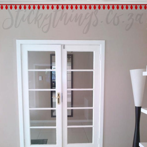 Red Christmas Bulb Wall Stickers installed along the ceiling cornice