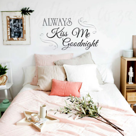 Kiss Wall Art Decal above a bed in a bedroom