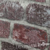 Clos up of the texture of the Embossed Red Brick Wallpaper